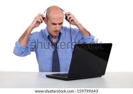 Bald businessman with laptop - stock photo