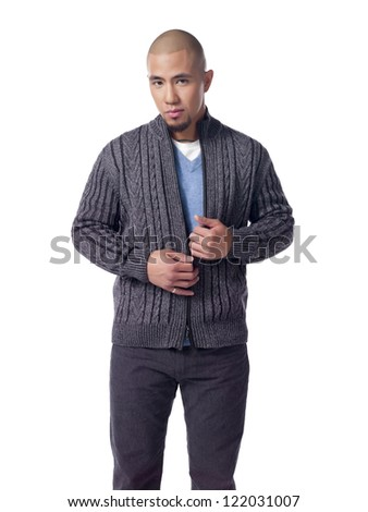 Bald handsome man holding his jacket while looking at the camera - stock photo