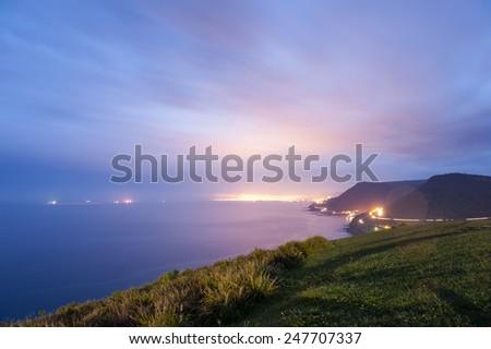 Bald Hill overlooks Sea Cliff Bridge which extends along the Grand Pacific Drive a 140 kilometre award winning coastal drive. - stock photo