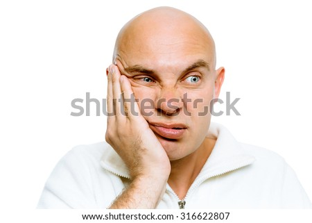 Bald man holding his hand to his cheek. Toothache or problem - stock photo