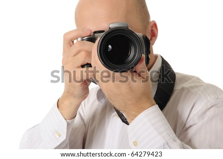bald man holds a camera in his hands. Isolated on white background - stock photo