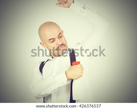 Bald man uses deodorant from a trigger. Sprayer. - stock photo
