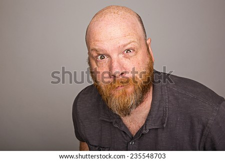 Bald man with beard - stock photo