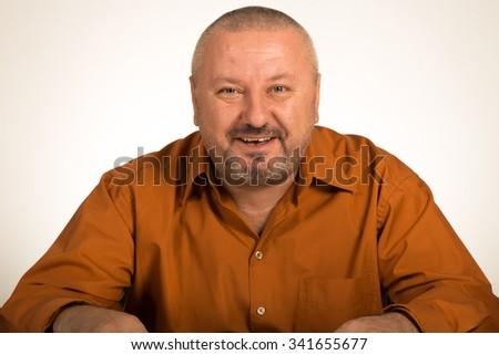 Bald man with beard smiling - stock photo