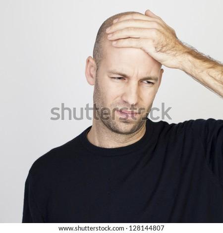 bald man with headache - stock photo