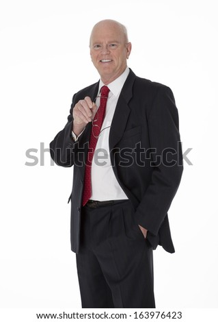 Balding cheerful mature businessman dressed in black business suit standing on white background - stock photo