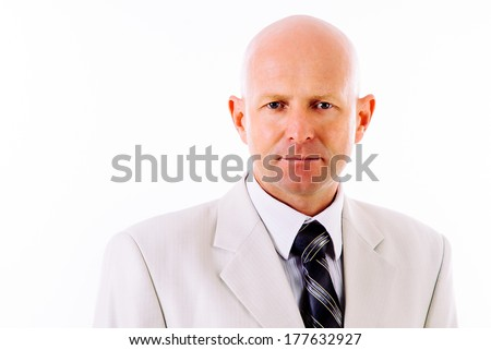 Balding cheerful mature businessman dressed in business suit standing on white background. Happy well dressed senior man. Isolated - stock photo