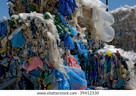 Baled plastic bags for recycling - stock photo