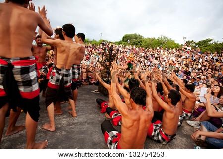 BALI - DECEMBER 30: traditional Balinese Kecak dance at Uluwatu Temple  on Dec 30, 2012, Bali, Indonesia - stock photo