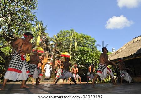 BALI -FEB14: Barong and Kris Dance at Sahadewah,in Batubulan, Gianyar,Bali, Indonesia on February14,2012.This famous Barong Play represents an eternal fight between good and bad spirits - stock photo