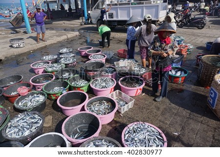 Bali Indonesia Apr 5, 2016:Barrels of fish sit on a dock after being unloaded from a boat at the port in Jimbaran on April 5, 2016.Jimbaran village is among famous place to see fisherman life in Bali. - stock photo