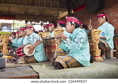 BALI, INDONESIA - APRIL 01: Musicians in the Gamelan troupe play traditional Balinese music to accompany dancers in a 'Barong Dance show' in Ubud village on April 01, 2011 in Bali, Indonesia. - stock photo