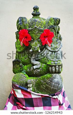 BALI, INDONESIA - FEBRUARY 17: Ornate monster statue at Ulun Danu temple on February, 17, 2011, Bali, Indonesia - stock photo
