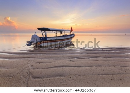 Bali, Indonesia. Fishing boats populate the shoreline at the Sanur Beach - stock photo