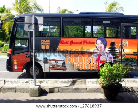 BALI, INDONESIA - JAN 29: Tourist police bus on January 29, 2013 in Bali, Indonesia. Bali Police have increased the numbers of tourist police officers, as over 15 million tourists visit Bali per year. - stock photo