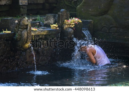 BALI,INDONESIA-2016 JUL 4: Pura Tirta Empul,Hindu Balinese water temple in Bali,Indonesia.famous for its holy spring water, where Balinese Hindus go to for ritual purification. - stock photo