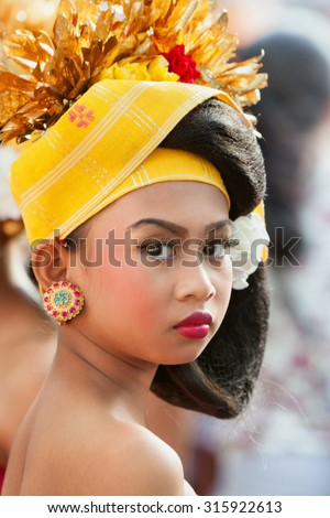 BALI, INDONESIA - JUNE 20: Face portrait of young dancer girl with jewellery dressed in traditional Balinese people costume dancing at Bali Art and Culture Festival in Denpasar, Bali on 20 June, 2015 - stock photo