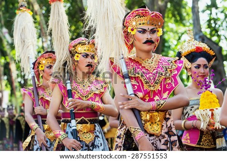 BALI, INDONESIA - JUNE 13: Unidentified people with traditional bright make-up on their faces and dressed in Balinese warrior costumes on parade at Bali Art Festival in Denpasar, Bali on 13 June, 2015 - stock photo