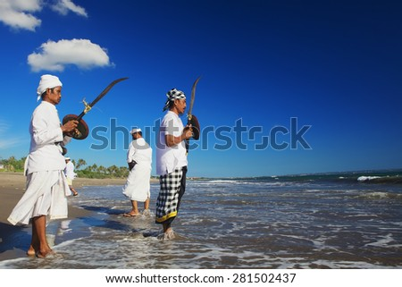BALI, INDONESIA - MARCH 18: Portrait of unidentified men with traditional ceremonial swords before ritual fighting dance during Melasti - religious ceremony of Balinese people, Bali on 18 March, 2015 - stock photo