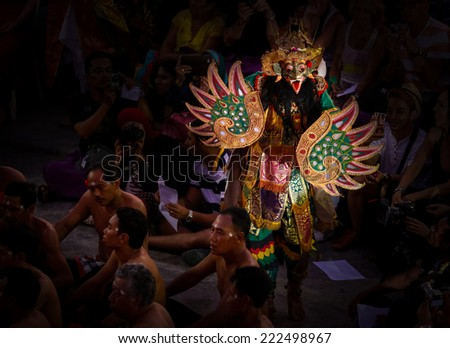 BALI, INDONESIA - SEPTEMBER 19, 2014: Characters from the Hindu mythology Ramayana appear in a staged presentation of the traditional Balinese Kecak Fire Dance held at the Uluwatu Temple in Bali. - stock photo
