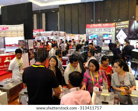 BALI, INDONESIA - SEPTEMBER 3 2015: Inter Food Bali Event. This is an exhibition of food and beverages, including wineries and coffee. The event was attended by famous chefs including Mandif Warokka. - stock photo