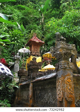 Bali: lovely and peaceful temple surrounded by wild nature, near Gitgit waterfalls. North Bali, Indonesia - stock photo