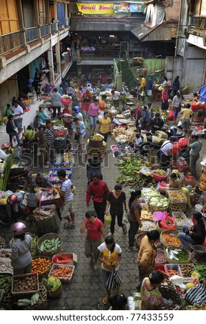 BALI - MAY 4: Commercial activities take place at Ubud market on May 4, 2011 in Bali, Indonesia. Ubud Market is very famous among Balinese, located in center of Ubud Village and in front of Ubud Palace. - stock photo
