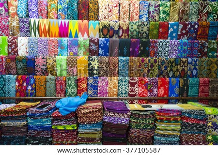 BALIKPAPAN, INDONESIA - FEB 8: Various design of batik painting displays in craft shop on Feb 8, 2016 in Pasar Inpress, Balikpapan, Indonesia. - stock photo