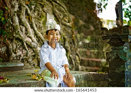 balinese boy in traditional costume - stock photo