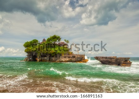 Balinese Tanah Lot temple, famous touristic landmark to visit at Bali, Indonesia - stock photo