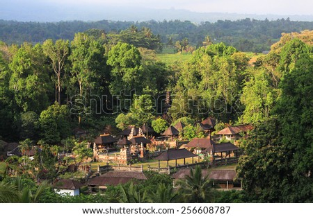 Balinese temple at sunset surrounded by jungle, Indonesia - stock photo