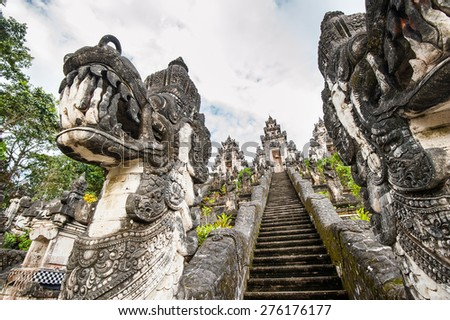 Balinese temple with dragon sculptures - stock photo