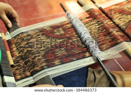 Balinese women weaving fabric Ikat, Bali, Indonesia - stock photo