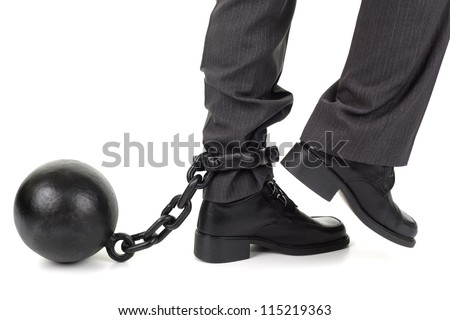Ball and chain restraining a businessman as he tries to walk - stock photo