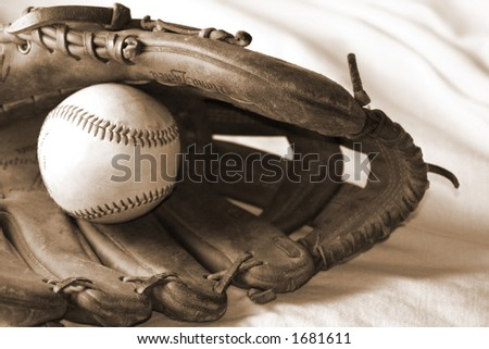 Ball and Glove, sepia-toned - stock photo