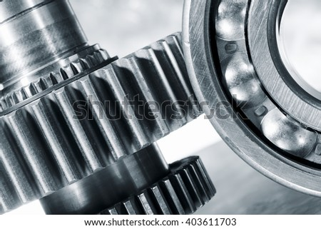 ball-bearing with cogs and gears, steel parts - stock photo