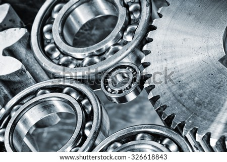 ball-bearings and cogwheels in a machinery concept - stock photo
