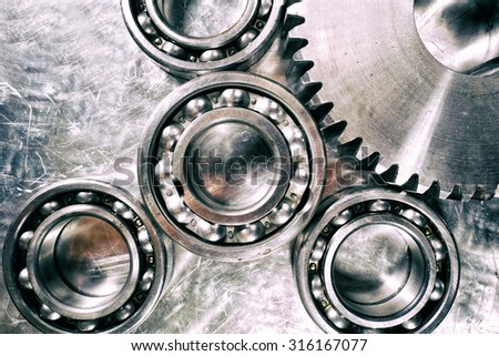ball-bearings and gears, titanium and steel aerospace parts - stock photo
