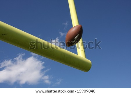 Ball being kicked through the uprights - stock photo