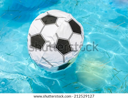 ball floating in a pool - stock photo