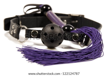 Ball-gag and whip, isolated on white background. Close up. - stock photo