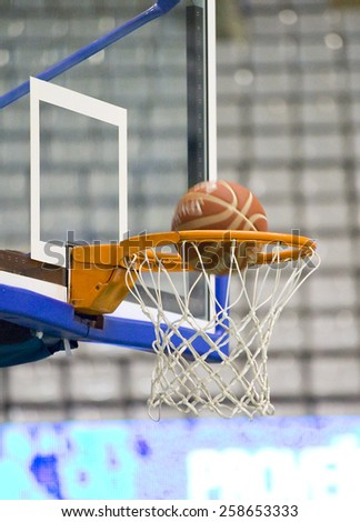 Ball inside the basketball net. - stock photo