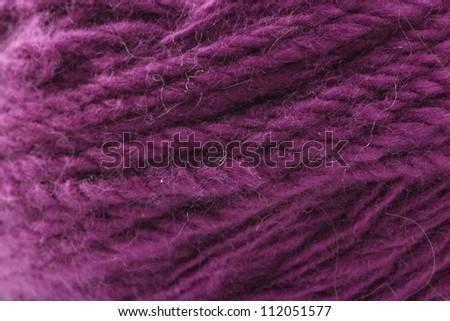 Ball of cyclamen yarn. closeup background - stock photo