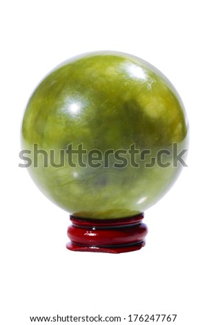Ball of green jade stone on the stand, isolated on white - stock photo