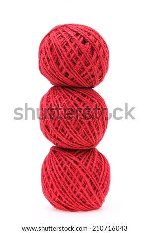 Ball of red threads on white background - stock photo