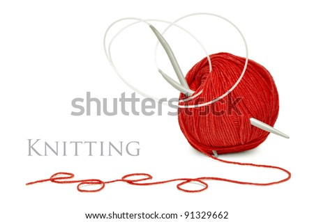 ball of red wool and knitting needles isolated on a white background - stock photo