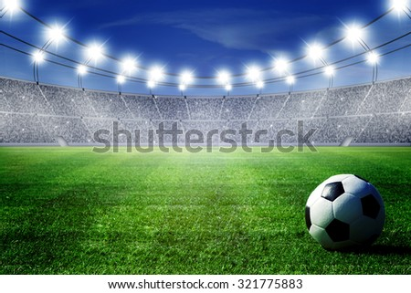 ball on field of stadium - stock photo