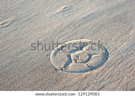 ball print in the sand - stock photo