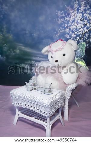 Ballerina/Angel Teddy Bear children's photo - Teddy full view having tea - stock photo