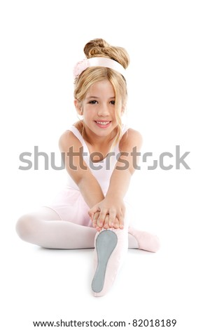 Ballerina children dancer sitting on white - stock photo